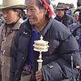 Tibetan man with prayer wheel