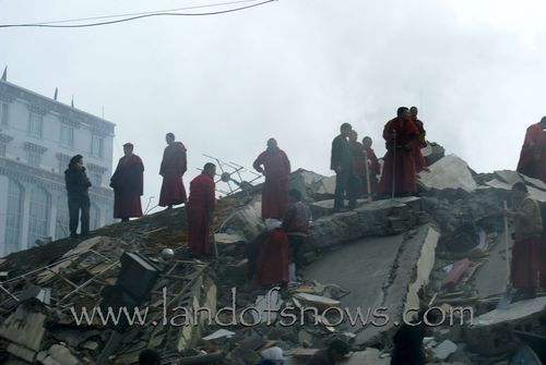 monks in the rubble looking for survivors
