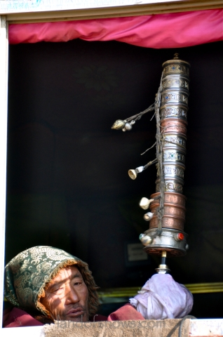 spinning a large prayer wheel