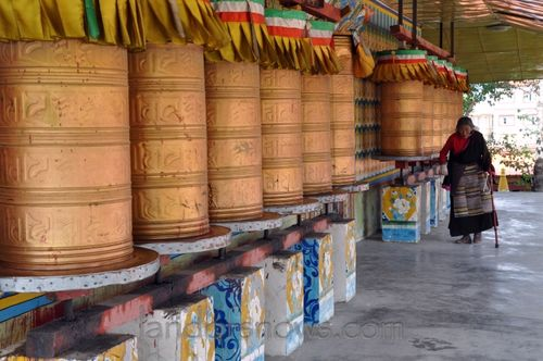 Spinning prayer wheels in Litang