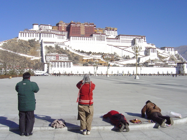 Prostration in front of the Potala